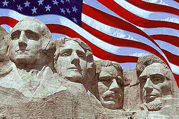 Mount Rushmore in front of an American Flag